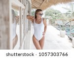 sexy girl in a white bathing... | Shutterstock . vector #1057303766