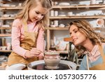 mother and daughter painting... | Shutterstock . vector #1057305776