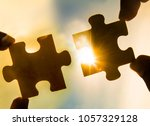 two hands trying to connect... | Shutterstock . vector #1057329128