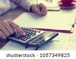 close up hands using calculator ...   Shutterstock . vector #1057349825