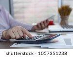 close up hands using calculator ... | Shutterstock . vector #1057351238