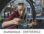 mechanic repairing gears of... | Shutterstock . vector #1057353512