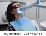 teeth whitening for woman.... | Shutterstock . vector #1057442465