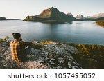 man sitting alone enjoying sea...   Shutterstock . vector #1057495052