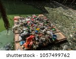 plastic trash floating in a... | Shutterstock . vector #1057499762