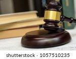 judge gavel beside pile of... | Shutterstock . vector #1057510235