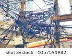 chaos   messy power cables  at... | Shutterstock . vector #1057591982