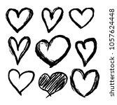 set of nine hand drawn heart.... | Shutterstock .eps vector #1057624448