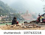 poor man sits on the banks of... | Shutterstock . vector #1057632218