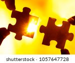 two hands trying to connect... | Shutterstock . vector #1057647728