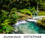 water flows down the mele... | Shutterstock . vector #1057659668