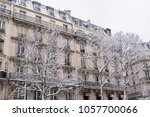 Small photo of Paris under the snow, typical building facades in winter, boulevard Voltaire, charming french area
