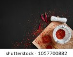 dried and crushed red chili... | Shutterstock . vector #1057700882