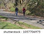 walkers stroll along  the burke ... | Shutterstock . vector #1057706975