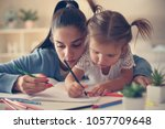 mother and daughter at home... | Shutterstock . vector #1057709648