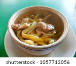 daylily soup with pork in a... | Shutterstock . vector #1057713056