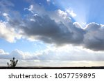 photo sky with cloud covering... | Shutterstock . vector #1057759895