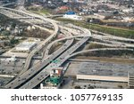aerial view of massive freeway  ... | Shutterstock . vector #1057769135
