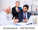 mature man is talking to... | Shutterstock . vector #1057819202