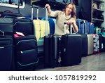 glad cheerful female customer... | Shutterstock . vector #1057819292