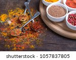 colorful spices in spoons on... | Shutterstock . vector #1057837805