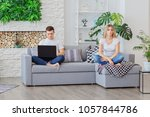 a guy looks at the laptop and... | Shutterstock . vector #1057844786
