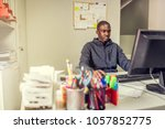 working online and turning a... | Shutterstock . vector #1057852775