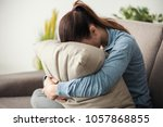 unhappy lonely depressed woman... | Shutterstock . vector #1057868855