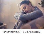 sad suffering woman curling on...   Shutterstock . vector #1057868882
