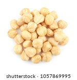peeled hazelnuts on white... | Shutterstock . vector #1057869995