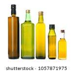 bottles with olive oil on white ...   Shutterstock . vector #1057871975