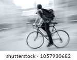 delivery on the bike in traffic ... | Shutterstock . vector #1057930682