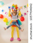 clown girl on the birthday of a ... | Shutterstock . vector #1057934042