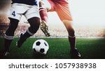 soccer football players red and ... | Shutterstock . vector #1057938938