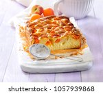 sponge cake with fresh apricot... | Shutterstock . vector #1057939868