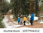 people with nordic sticks... | Shutterstock . vector #1057946312