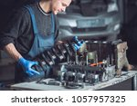 master collects a rebuilt motor ... | Shutterstock . vector #1057957325