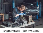 master collects a rebuilt motor ... | Shutterstock . vector #1057957382