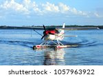 Single engine seaplane turns in the water and prepares to stop at Wooten Park, Tavares, Florida.