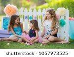 three beautiful young girls... | Shutterstock . vector #1057973525
