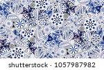 abstract blue flower pattern... | Shutterstock .eps vector #1057987982