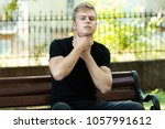 portrain of young man with sore ... | Shutterstock . vector #1057991612