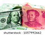 Us Dollar Bill And China Yuan...