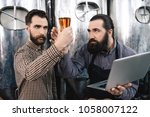 two bearded brewers check... | Shutterstock . vector #1058007122