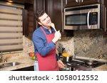handsome hispanic young man in... | Shutterstock . vector #1058012552