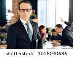 serious adult man in suit... | Shutterstock . vector #1058040686