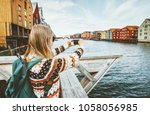 tourist woman taking photo by... | Shutterstock . vector #1058056985