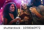 happy young women partying... | Shutterstock . vector #1058060972