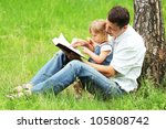 father and daughter reading the ... | Shutterstock . vector #105808742