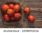 blood orange fruit in a wicker... | Shutterstock . vector #1058092016